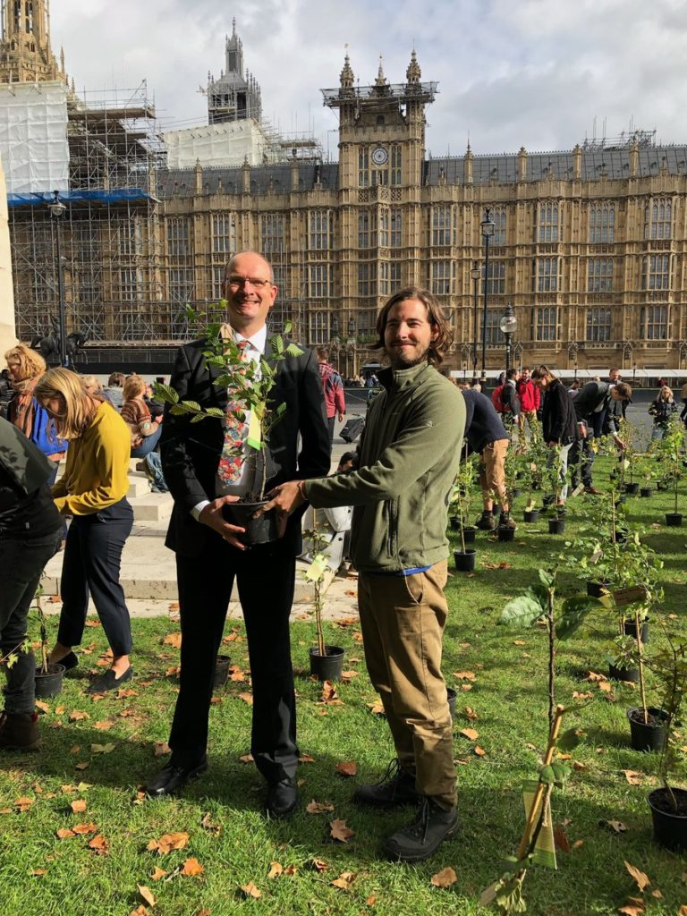 Sandy picking up his tree from Extinction rebellion organisers